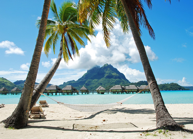 Bora Bora should be added to your best beaches to see in 2015 list for it's beautiful villas that line the beach and sometimes hang over the water.