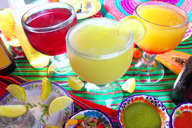 Don't drink your calories while on vacation with slushy, tropical drinks. Balance each alcoholic drink with a glass of water to help eat healthy on vacation.