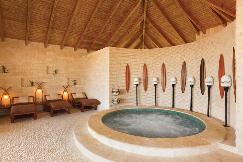 Spa pool and chairs with bubbling water at the Hyatt Zilara Rose Hall spa luxury all inclusive resort