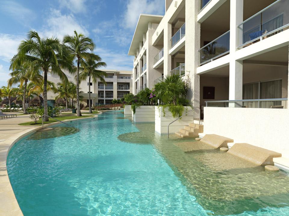 Blue shining waters of Paradisus La Esmeralda luxury all inclusive resort swim-up room