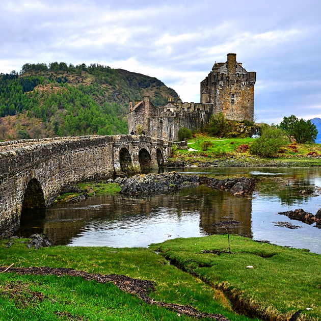 Experience Scotland by visiting the Eilean Donan Castle for a taste of the country's history and stunning landscapes.