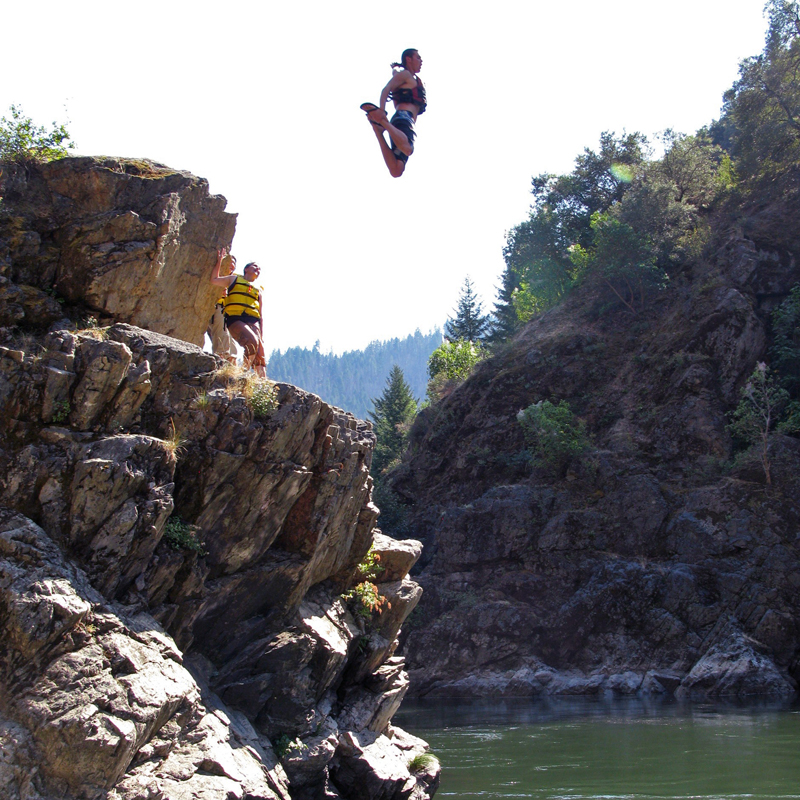 Diving into the Rogue River. Courtesy of Travel Oregon, photo by Kevin Wright.