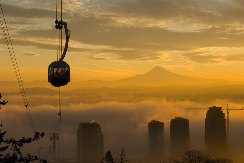 Aerial Tram with fog over the Willamette River with Mt. Hood at sunrise. Courtesy of Travel Portland