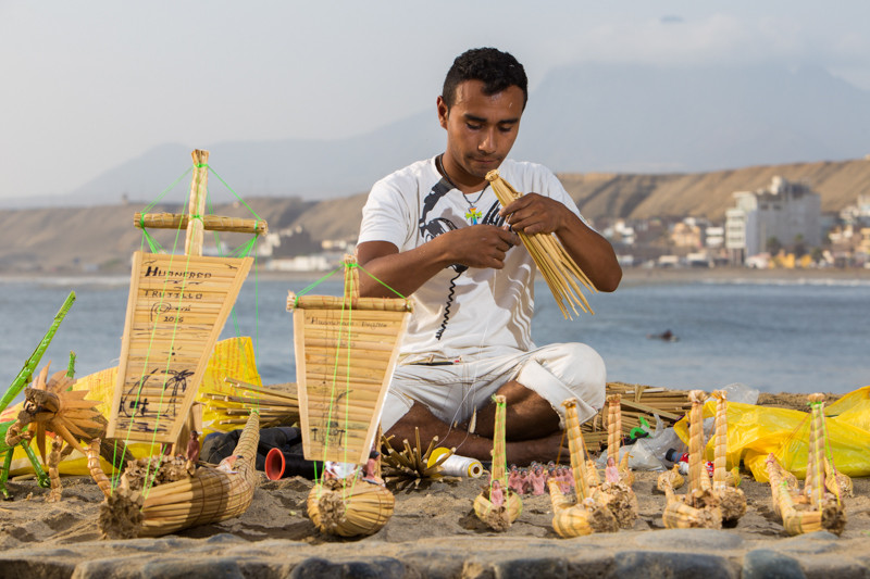 This guy was making reed souvenirs by hand at the pier. Photo courtesy of Brendan's Adventures