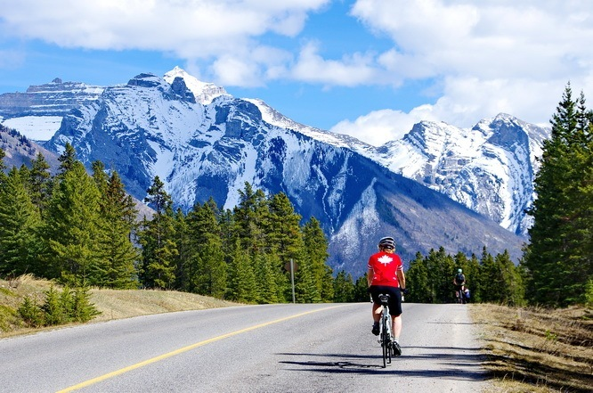Cycling the road to Lake Minnewanka in Banff National Park, photo courtesy of HikeBikeTravel.com