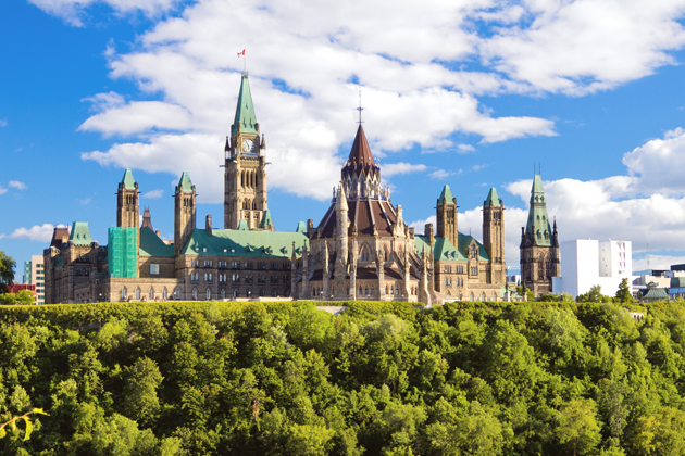 Parliament Hill overlooks the Ottawa River and is a spectacular place to visit in Ottawa for history, culture, and architecture.