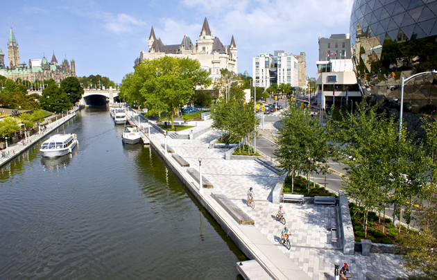 The Rideau Canal running through downtown Ottawa is a spectacular walk for the summer and skate in winter months