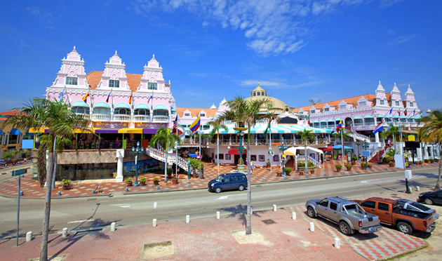Oranjestad, Aruba with buildings in background, palm tree lined street