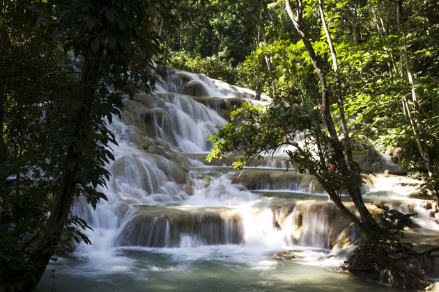 Water cascading down Dunn's River Falls waterfalls in Jamaica, a must in our Montego Bay travel guide