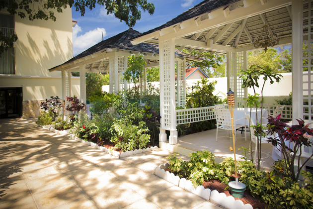 A special meal at the Breezes Bahamas all-inclusive resort garden patio restaurant is available