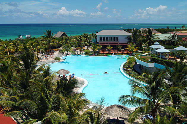 View of pool at adults only Melia Cayo Coco surrounded by palm trees