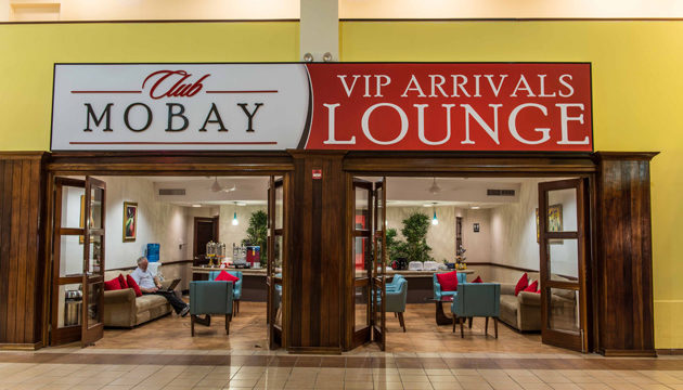 Club MoBay arrival lounge seen through large sign