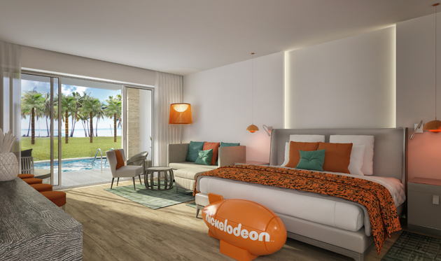 Nickelodeon Punta Cana suite Punta Cana room with bed, couch, sitting area, looking out towards beach and outside