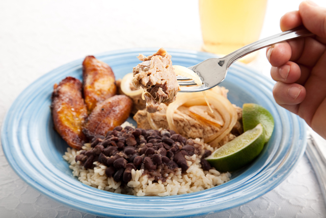 Food in Cuba traditional meal plate of rice and beans and pork