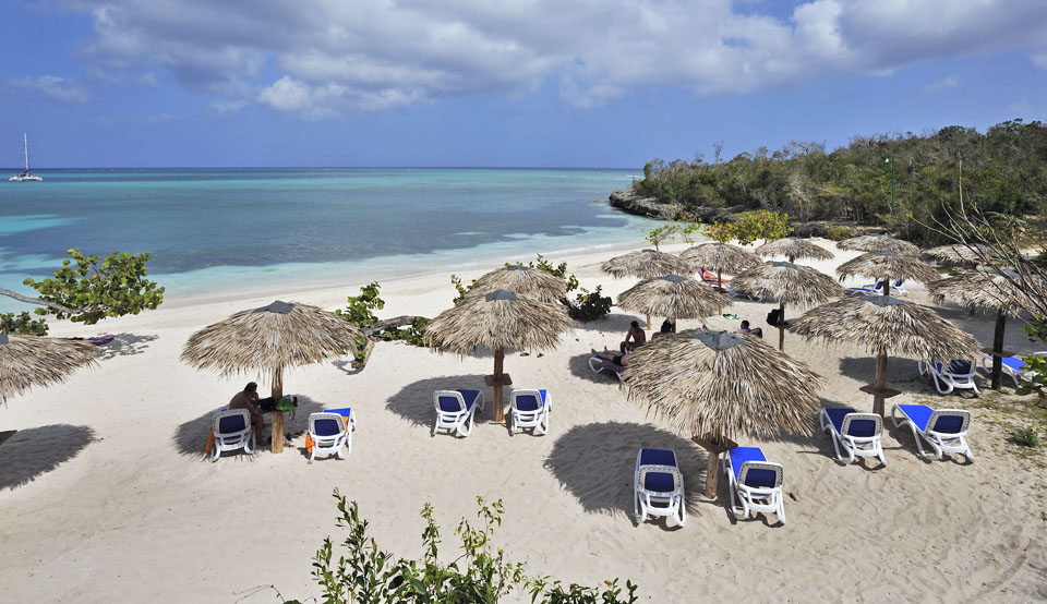 View of beach with palapas at Paradisus Rio de Oro Cuba adults only resort
