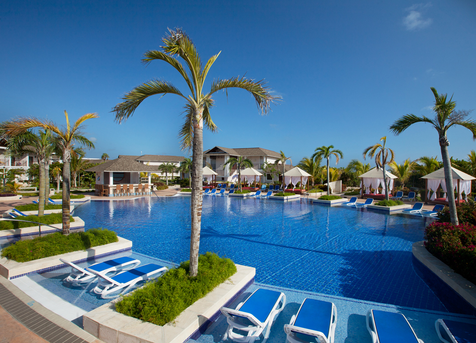 View of pool with lounge chairs at Royalton Cayo Santa Maria adults only cuba resort