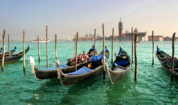 Gondolas on Grand Canal in front of San Giorgio Maggiore church - Venice, Italy