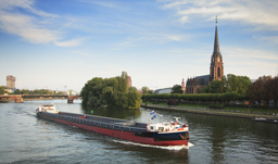 Barge moving along Main River - Frankfurt, Germany