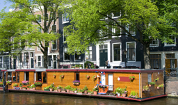 Houseboat along the canal - Amsterdam, Netherlands