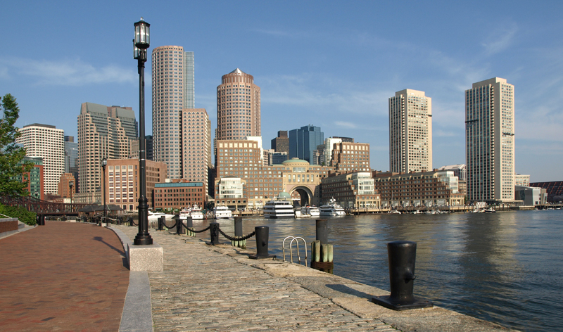 Boston Harbor waterfront with skyline in background (Image Credit: Tripcentral.ca)